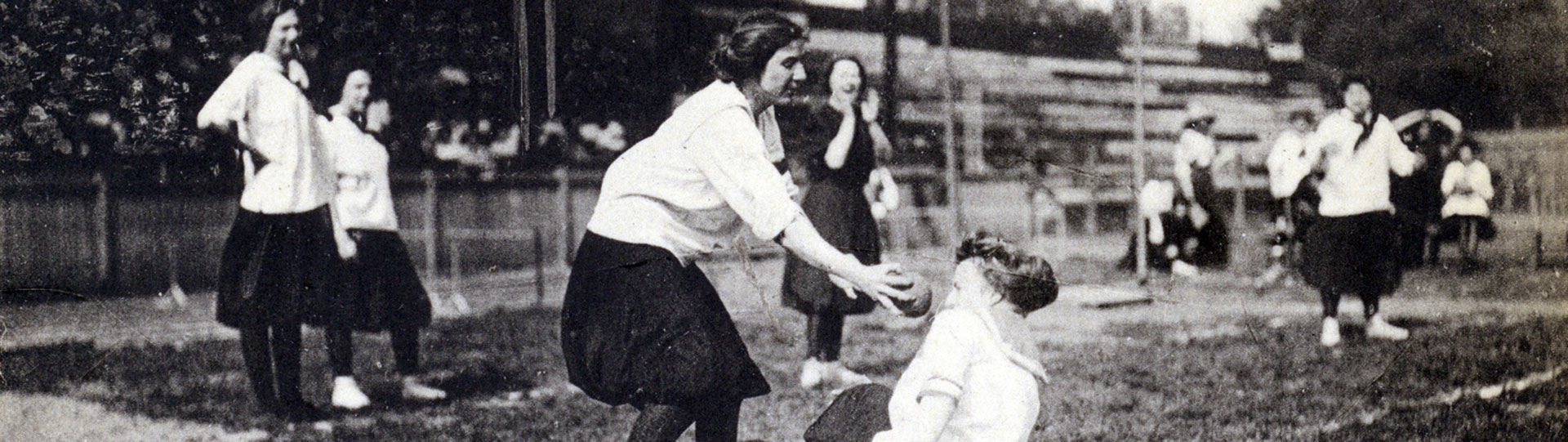 Photo of students playing ball from archives and special collections