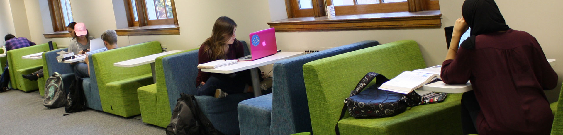 Photo of Student in Library Stacks