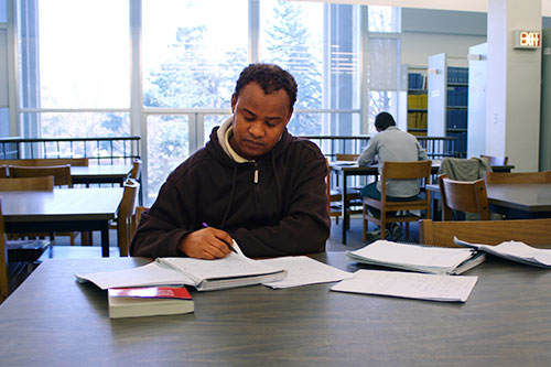 Photo of students using study rooms.