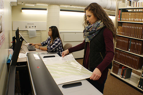 Photo of students using the large scanner
