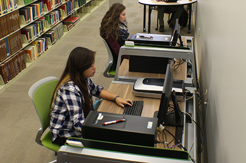Photo of students using computer stations.