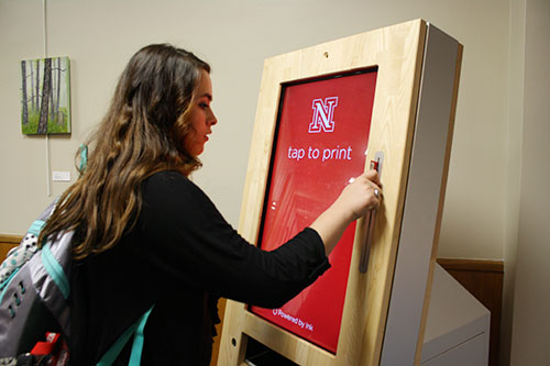 Photo of student using print kiosk
