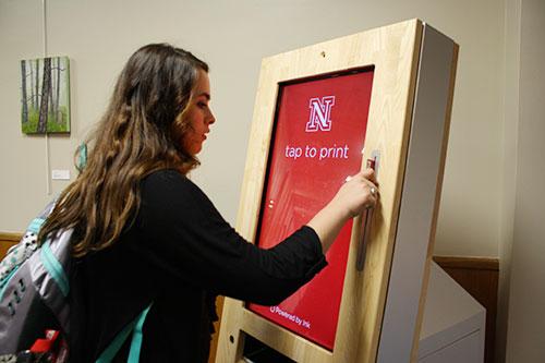 Student uses a print kiosk.