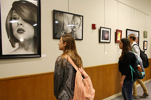 Photo of students at Annual University of Nebraska-Lincoln Staff Art Show